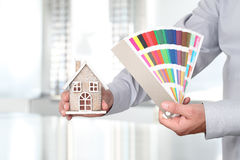 Hands with house and swatches, interior design Stock Photo