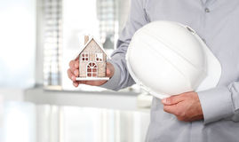 Hands with house and work helmet, construction concep Royalty Free Stock Photography
