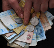 In the hands of human small Ukrainian money Stock Photography