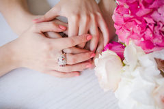 Hands of husband and wife Stock Photos