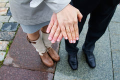 Hands of husband and wife with rings Stock Photos