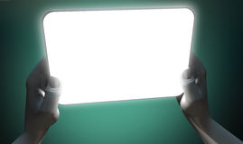 Hands And Illuminated Generic Tablet Royalty Free Stock Images