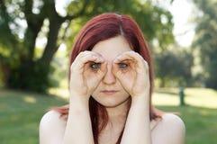 Hands imitating binoculars Stock Photo