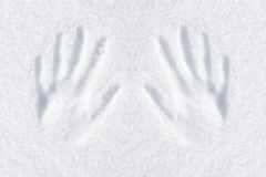 Hands impression. In fresh snow royalty free stock photo