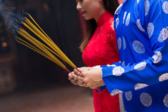 Hands with incense sticks Royalty Free Stock Images