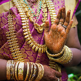 Hands of an Indian bride adorned with jewelery. Bangles and painted with henna Stock Image