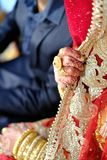 Hands of an Indian bride adorned with jewelery and wedding ring Royalty Free Stock Photography