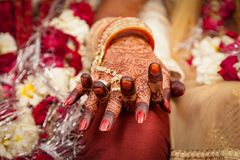 Hands of an Indian Bride, Mehndi or Henna during a wedding ceremony. Hands of an Indian Bride, tattooed with natural and local dye, Mehndi or Henna during a royalty free stock photography