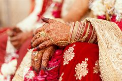 Hands of an Indian Bride, Mehndi or Henna during a wedding ceremony. Hands of an Indian Bride, tattooed with natural and local dye, Mehndi or Henna during a stock images
