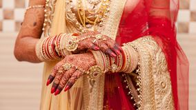 Hands of an Indian Bride, Mehndi or Henna during a wedding ceremony. Hands of an Indian Bride, tattooed with natural and local dye, Mehndi or Henna during a royalty free stock images