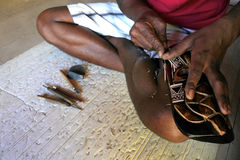 Hands of Indigenous Fijian man wood carving a sea turtle Stock Images