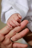 Hands. Infant reaching out to grab her mother hand Stock Photography