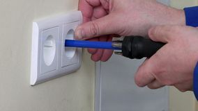 Hands install electrical wall sockets stock footage