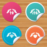 Hands insurance icons. Family life-assurance. Round stickers or website banners. Hands insurance icons. Couple and family life insurance symbols. Heart health Royalty Free Stock Photos