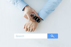 Hands with internet browser search on smartwatch Royalty Free Stock Image