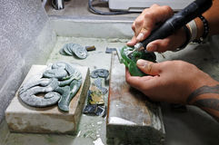 Hands of a Jade ornamental green rock carver at work