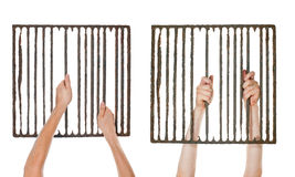 Hands on jail grating Royalty Free Stock Photo