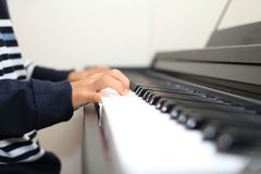 Hands of Japanese boy playing a piano Stock Photography
