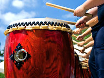 Hands and Japanese drums Royalty Free Stock Images