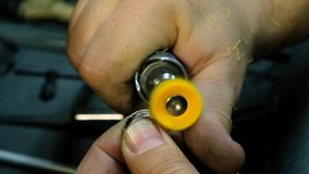 Hands of the jeweler polishes ring on the polishing machine. Goldsmith working on his workbench