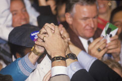 Hands join for Governor Bill Clinton during a Denver campaign rally in 1992 on his final day of campaigning in Denver, Colorado Stock Photo