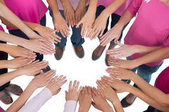 Hands joined in circle wearing pink for breast cancer Royalty Free Stock Photos
