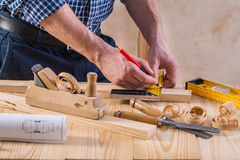 Hands of joiner with pencil Royalty Free Stock Photo