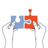 Hands joining puzzle piece - association concept Stock Photos