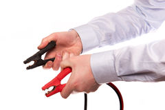 Hands with jumper cables Stock Photo