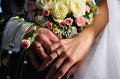 Hands of just married couple stock photos