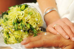 Hands Of A Just Married Couple With Bridal Bouquet Royalty Free Stock Photo