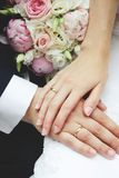 Newlyweds hands & peony Royalty Free Stock Photos