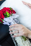 Hands of just married woman holding bouqet Royalty Free Stock Photo