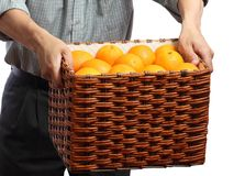 Hands keep box of oranges. On a white background Royalty Free Stock Photos