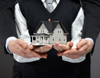 Hands keeping house model Stock Photography
