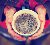 Hands keeping warm, holding a hot cup of tea or coffee Royalty Free Stock Image