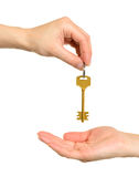 Hands and key Stock Images