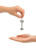 Hands and key Stock Photography