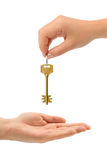 Hands and key Royalty Free Stock Image