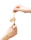 Hands and key with blank label Royalty Free Stock Photo