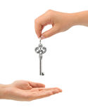 Hands and key Royalty Free Stock Images