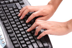 Hands on keyboard. Hands typing on a keyboard Stock Photography