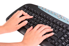 Hands on keyboard. Hands typing on a keyboard Stock Photo