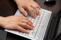 Hands on keyboard Stock Images