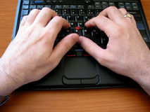 Hands on keyboard Stock Photography
