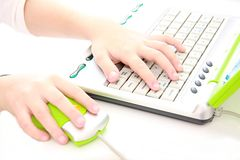 Hands on keyboard. Childs' hands on computer mouse and key board Royalty Free Stock Images