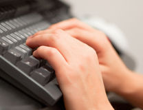Hands on the keyboard. Brushes of hands on the black keyboard Stock Images