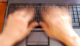 Hands on keyboard, fast typing Stock Photography