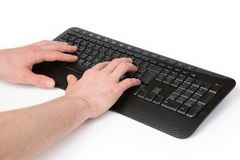 Hands on a Keyboard Stock Photos