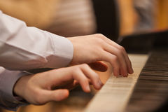 Hands on the keyboard of the piano Royalty Free Stock Image